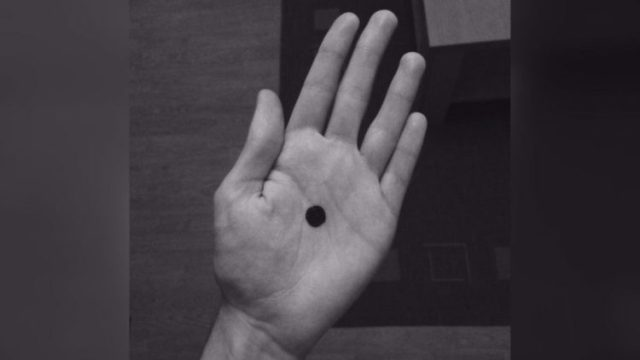Look Out For A Black Dot On Someone's Palm…It Means More Than You Think